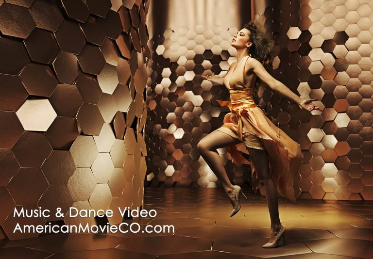Dance Video: Beautiful Dancer in gold dress against gold set.