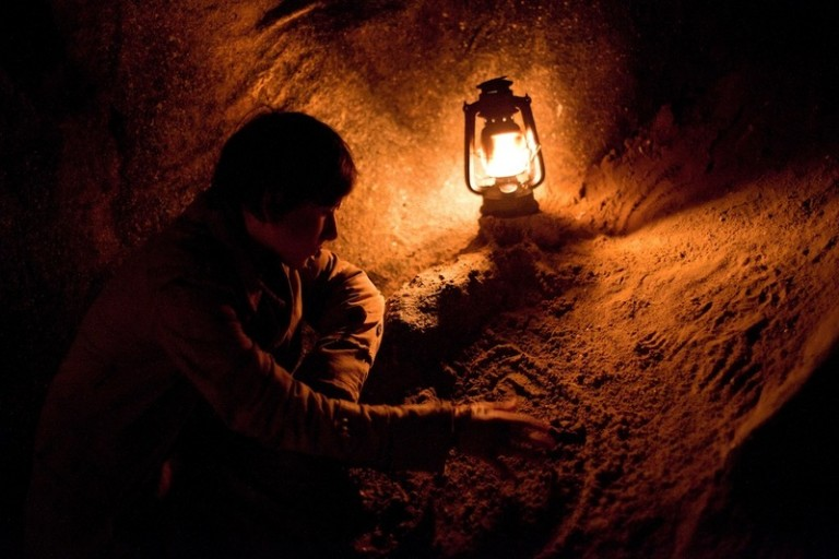 Better to go under the Earth living than dead. The Stermer family plunges into the cold dark of the Earth for safety.