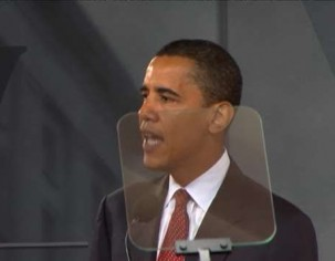 President Obama using a presidential teleprompter during a speech.