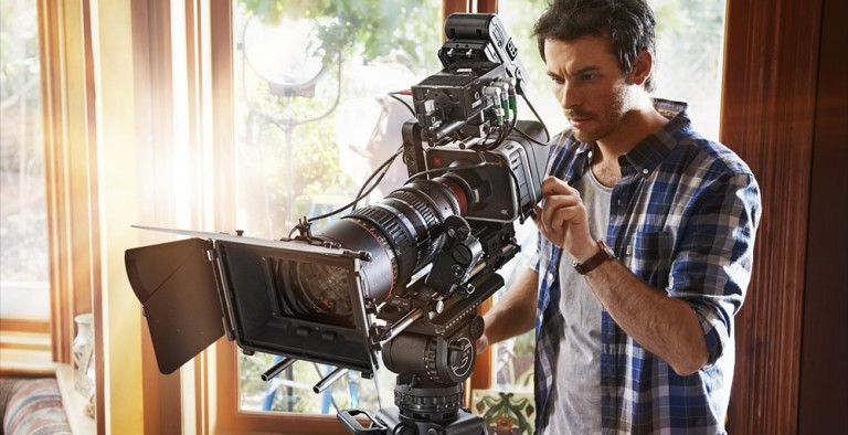 Black Magic 4K CineCamera with huge Zoom Lens and camera man