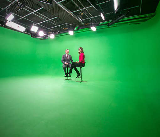 Green Screen Studio - 2 people sitting on stools