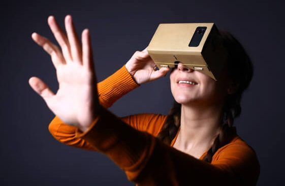 Virtual Reality Google Cardboard user - young woman looks