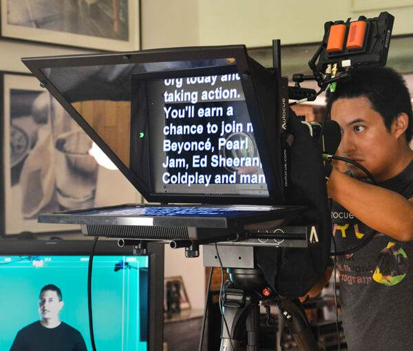 12 inch Standard Teleprompter rental in action on set. Operator next to it.