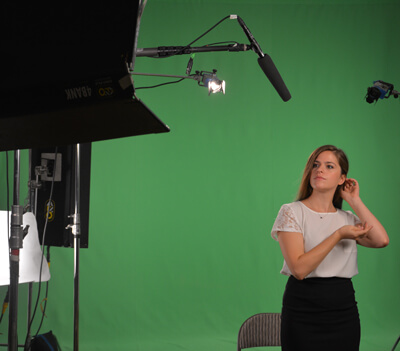 Young woman in front of Green Screen - commercial production