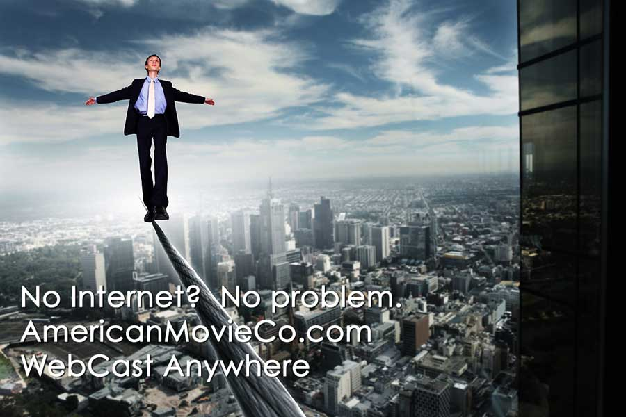 man walking on tightrope between high buildings for a webcast