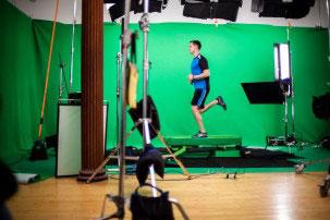 man running on green screen treadmill
