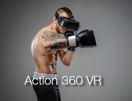 Guy with tats and VR headset seeming to box
