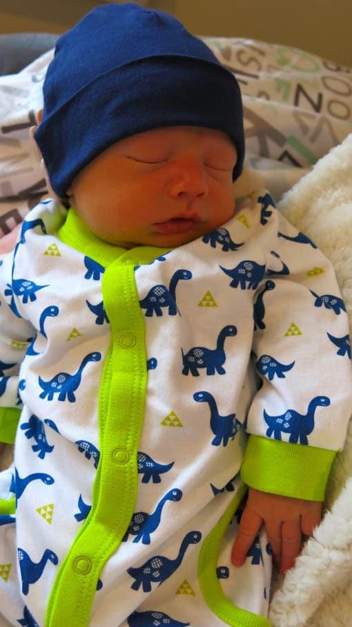 Declan sleeping wearing blue hat