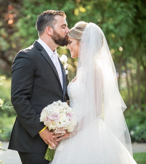 James and Ashley kiss on forehead