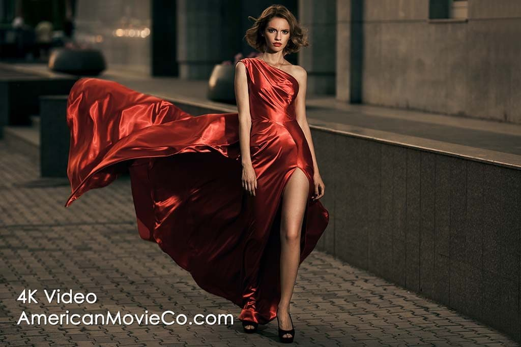 young model in fluttering red dress