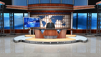Newscaster behind desk