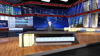 Anchor behind desk - wide shot of studio, red crawl above