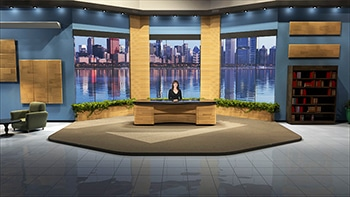 Wide view of set - anchor behind desk