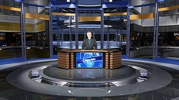 Anchorman behind desk - virtual set