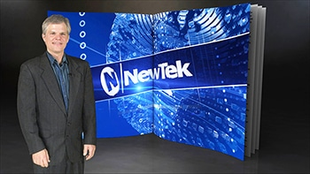 Man standing next to NEWTEK logo