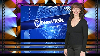 Huge screen NEWTEK woman standing in front of it