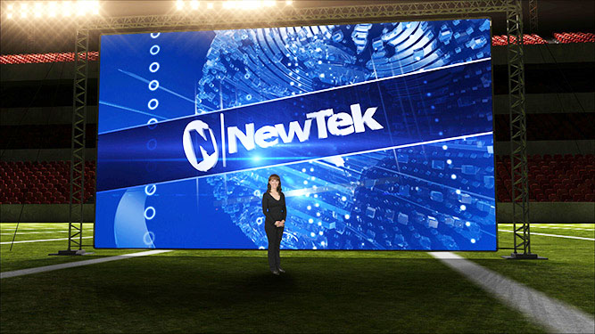 Huge screen - NEWTEK - diminutive woman in front