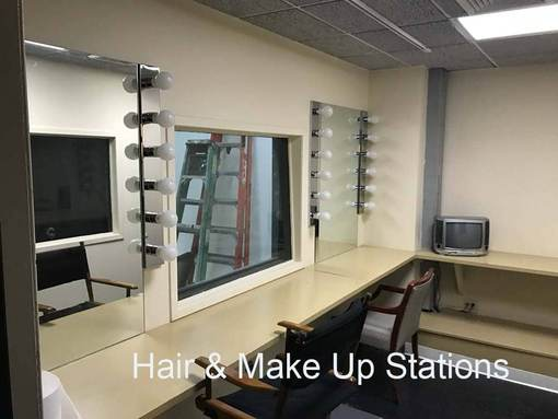 Chelsea Central hair and makeup station . Two Mirrors and chairss with lights and large window into studio