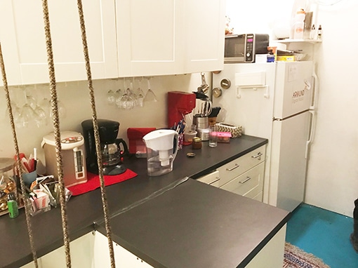 Budget Kitchen in Tribeca white cyc stage, small cluttered kitchen