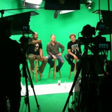 Green Screen Video Production, 3 Men on Stools in front of Cameras. AMC Green Screen sound stage Studio Rental