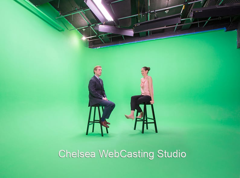LargeGreen Screen two walled cyc with two people sitting no stools in the center