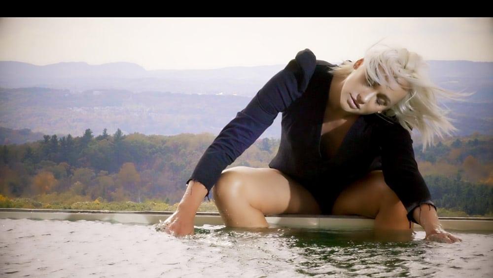 Blonde Model in black near lake Webcast Live Stream Video