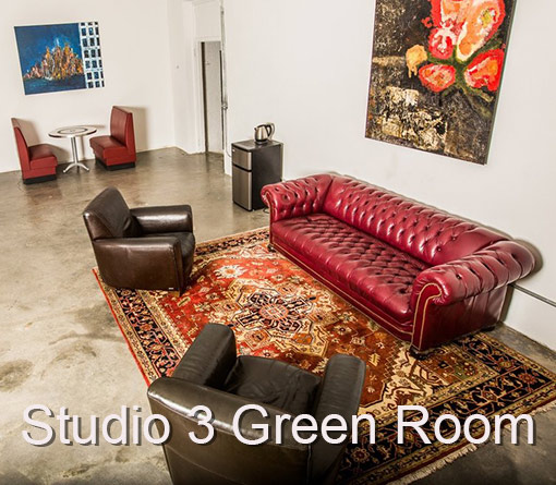 Studio 3 Green Room . Re Couch, white walls , table and chairs