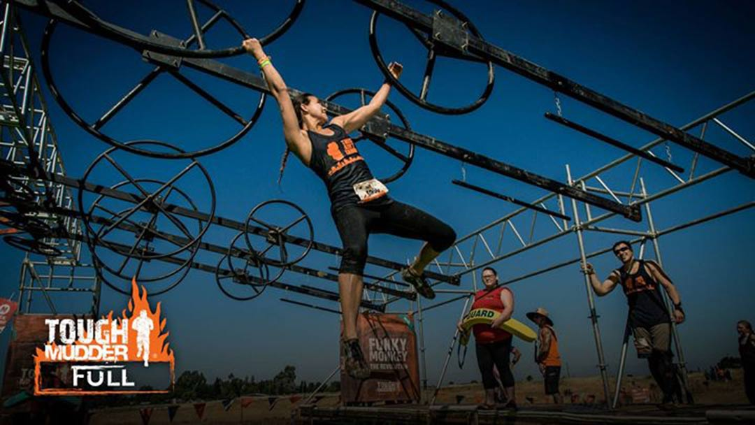 Tough Mudder training course overhead rings with woman gymnast