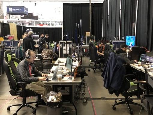 PAX - Desk rows - guy with earphones