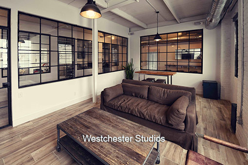 Westchester Studios Industrial_meeting_space brown leather couches