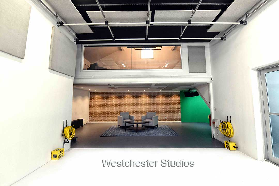 Westchester Studios The Studio 1 brick wall, two chairs