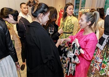 Group of beautiful Chinese women in designer gowns