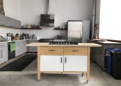 Portable kitchen top on wheels. - cabinets, fridge - white cabinets on wooden piece