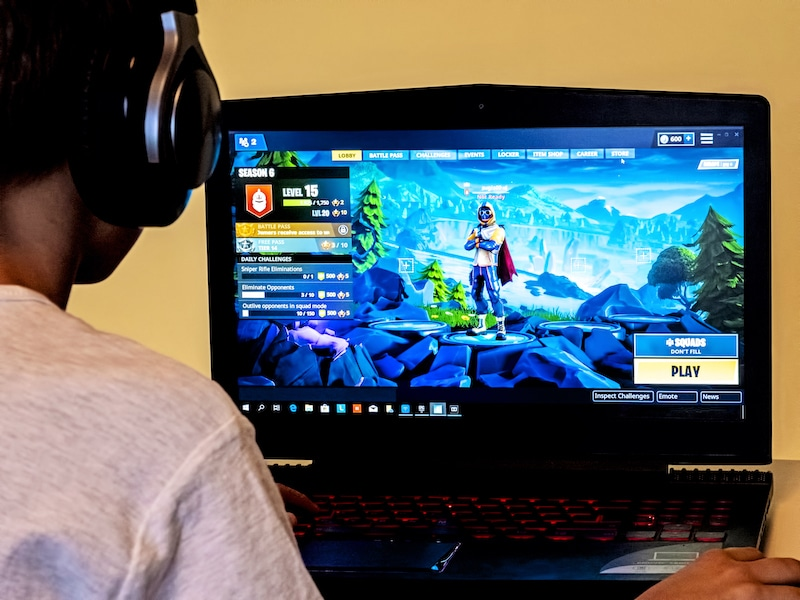 Fortnight Player, Boy playing Fortnite. Fortnite is online video game developed by Epic Games.