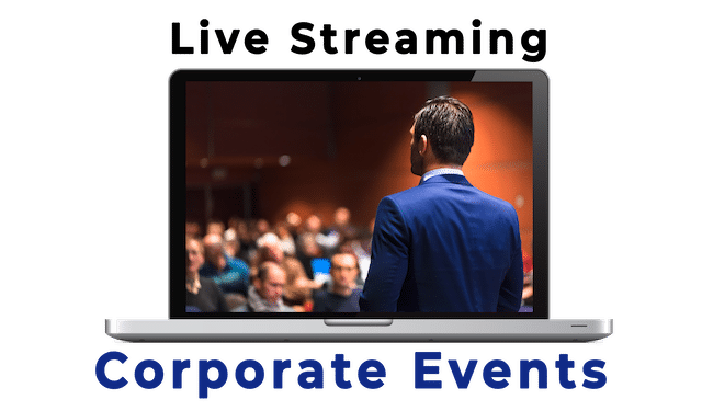 Live Streaming Corporate Events - Man seen from the back addfressing a room full of people in soft focus.