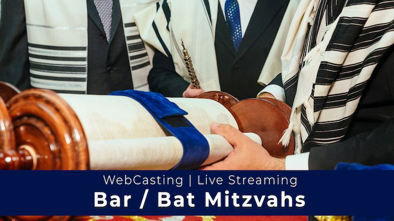 Close up of Torah being held by males - WebCasting of Bar/Bat Mitzvah