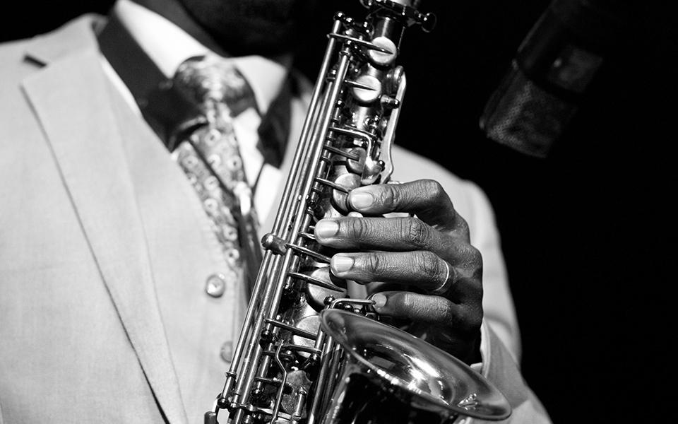 Black jazz musician with sax