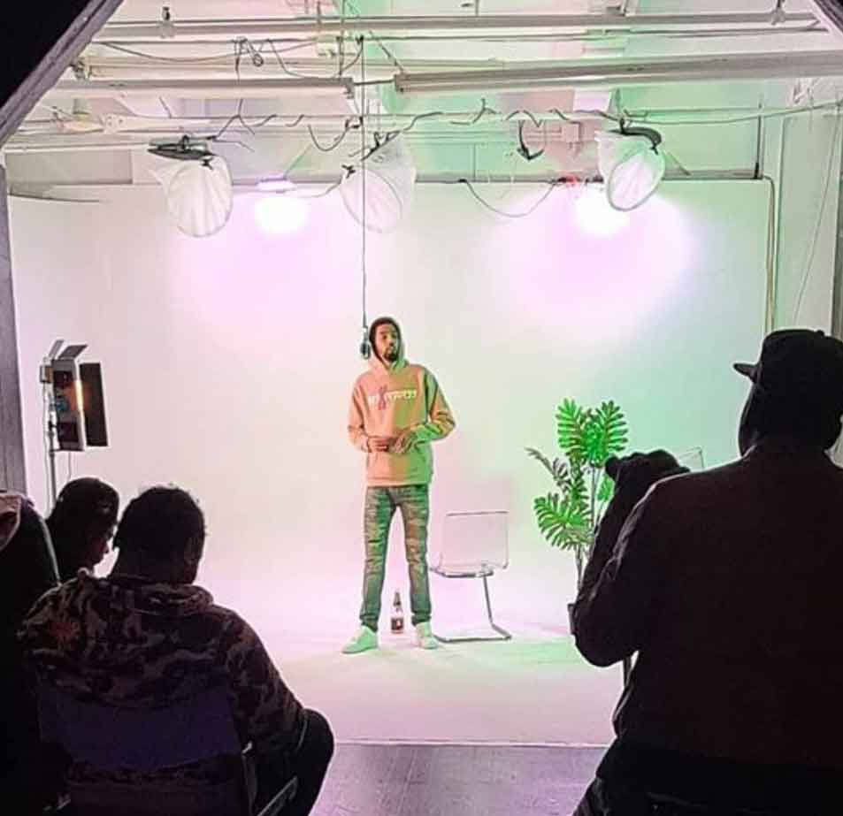 Behind the scenes shooting a music video at Midtown green Screen and white cyc studio, singer in front of white cyc
