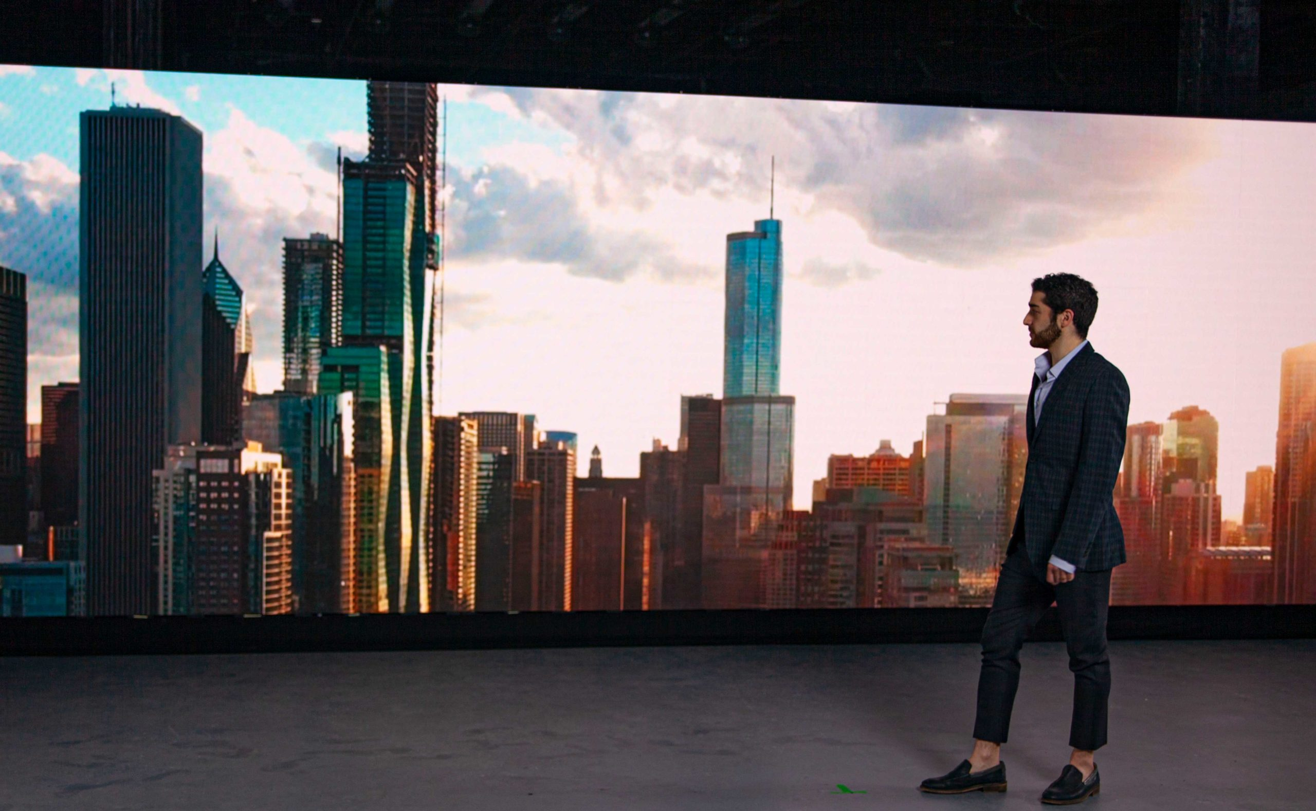 Walking in front of city skyline LED video Wall